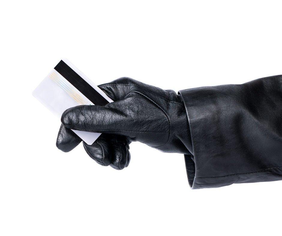 man with glove holding card